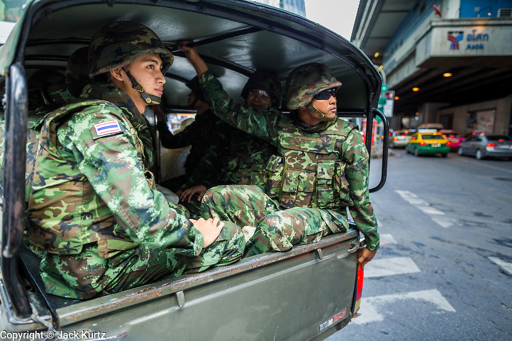 "01 JUNE 2014 - BANGKOK, THAILAND: Thai soldiers in a truck arrive at Terminal 21, a Bangkok shopping mall, to put down a protest in the mall. The Thai army seized power in a coup that unseated a democratically elected government on May 22. Since then there have been sporadic protests against the coup. The protests Sunday were the largest in several days and seemed to be spontaneous ""flash mobs"" that appeared at shopping centers in Bangkok and then broke up when soldiers arrived. Protest against the coup is illegal and the junta has threatened to arrest anyone who protests the coup. There was a massive security operation in Bangkok Sunday that shut down several shopping areas to prevent the protests but protestors went to malls that had no military presence.    PHOTO BY JACK KURTZ"