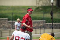 New VMI defensive coordinator Greg Harris warms up his players prior to the start of Saturday's spring scrimmage at Foster Stadium.