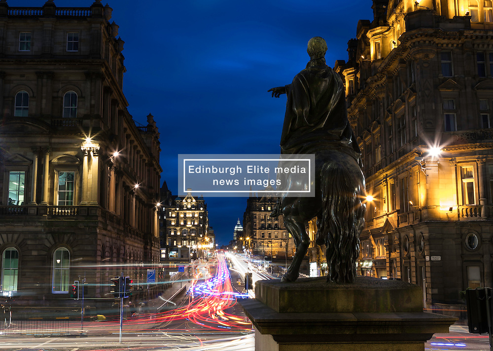 The statue of the Duke of Wellington was sculpted by Sir John Steel in 1852 and erected outside Register House on Edinburgh's Princes Street. The Duke points to the busy junction with North Bridge as cars speed by.