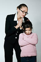 studio shot of a young woman having problem educate her child