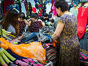 14 JUNE 2018 - SEOUL, SOUTH KOREA: Women shop for clothes in Namdaemun Market. Namdaemun Market is one of the oldest continually running markets in South Korea, and one of the largest retail markets in Seoul. The streets in which the market is located were built in a time when cars were not prevalent, so the market itself is not accessible by car. The main methods of transporting goods into and out of the market are by motorcycle and hand-drawn carts. It occupies many city blocks, which are blocked off from most car traffic due to the prevalence of parking congestion in the area.       PHOTO BY JACK KURTZ
