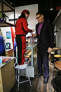 ZHENGZHOU, CHINA - FEBRUARY 17: (CHINA OUT)<br /> <br />  Aisa's Tallest Man Comes To Zhengzhou in China<br /> <br /> A shop assistant gives food to Zhang Huan on February 17, 2016 in Zhengzhou, Henan Province of China. Zhang Huan was 2.38 meters tall and known to be the tallest man in Asia.<br /> ©Exclusivepix Media