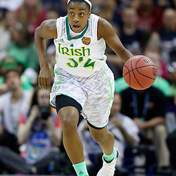 April 7, 2013; New Orleans, LA, USA; Notre Dame Fighting Irish guard Jewell Loyd (32) dribbles against the Connecticut Huskies during the first half in the semifinals during the 2013 NCAA womens Final Four at the New Orleans Arena. Mandatory Credit: Derick E. Hingle-USA TODAY Sports