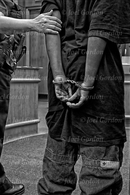 Juvenile sentened and handcuffed, taken back to holding cell to be transferred to jail.Judge Roger J. McDonald - Juvenile Justice Center - Ninth Judicial Circuit Court of Florida - Orlando, FL.
