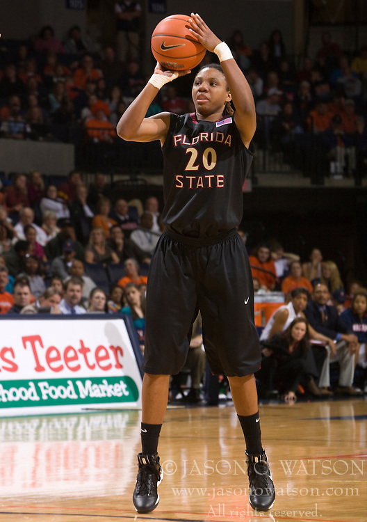 Florida St. guard Tanae Davis-Cain (20) shoots a three point jump shot against UVA.  The #16 ranked Virginia Cavaliers fell to the #22 ranked Florida State Seminoles 80-75 in NCAA Women's Basketball at the John Paul Jones Arena on the Grounds of the University of Virginia in Charlottesville, VA on January 23, 2009.