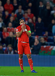 CARDIFF, WALES - Friday, November 16, 2018: Wales' captain Ashley Williams looks dejected as Denmark score the opening goal during the UEFA Nations League Group Stage League B Group 4 match between Wales and Denmark at the Cardiff City Stadium. (Pic by David Rawcliffe/Propaganda)