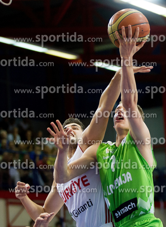 Ayhan Kentli of Turkey vs Klemen Prepelic of Slovenia during basketball match between National teams of Turkey and Slovenia in Qualifying Round of U20 Men European Championship Slovenia 2012, on July 17, 2012 in Domzale, Slovenia. (Photo by Vid Ponikvar / Sportida.com)
