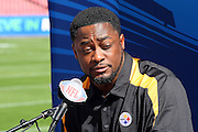 TAMPA, FL - JANUARY 27: Head Coach Mike Tomlin of the AFC Pittsburgh Steelers speaks to the media during Super Bowl XLIII Media Day at Raymond James Stadium on January 27, 2009 in Tampa, Florida. ©Paul Anthony Spinelli *** Local Caption *** Mike Tomlin