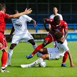 Dovers defender Josh Passley is wresstled to the ground by Wrexhams forward Stuart Beavon during the opening National League match between Dover Athletic and Wrexham FC at Crabble Stadium, Kent on 04 August 2018. Photo by Matt Bristow.