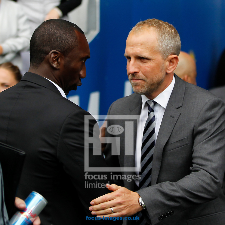 Paul Trollope of Cardiff City and Jimmy Floyd Hasselbaink of Queens Park Rangers during the Sky Bet Championship match at the Cardiff City Stadium, Cardiff<br /> Picture by Mike Griffiths/Focus Images Ltd +44 7766 223933<br /> 14/08/2016