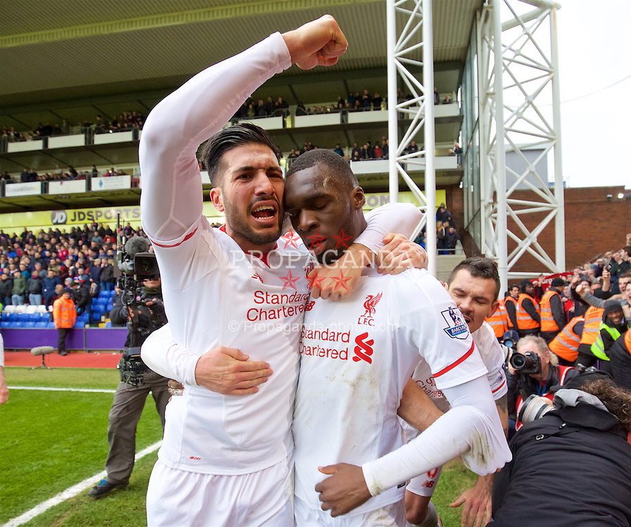 LONDON, ENGLAND - Sunday, March 6, 2016: Liverpool's Christian Benteke celebrates with team-mate Emre Can after scoring the second goal against Crystal Palace from a penalty kick in the last minute of injury time to seal a 2-1 victory during the Premier League match at Selhurst Park. (Pic by David Rawcliffe/Propaganda)