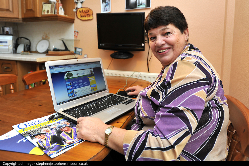 ©INS News Agency Ltd...  14/10/2010.Francis Taylor (61) sits at her dining table browsing the internet.