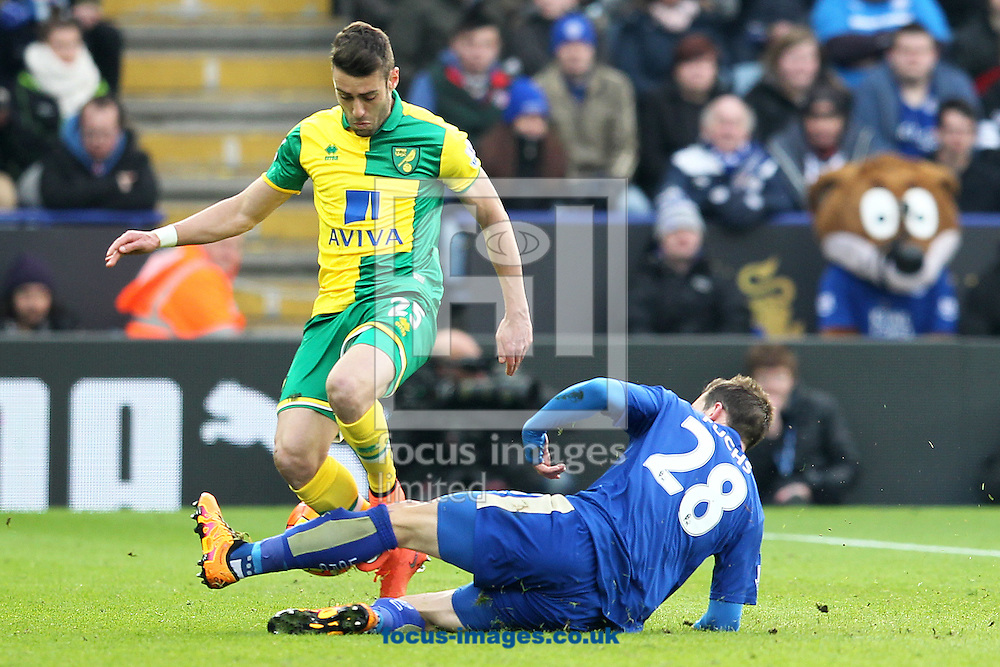 Ivo Pinto of Norwich is tackled by Christian Fuchs of Leicester City during the Barclays Premier League match at the King Power Stadium, Leicester<br /> Picture by Paul Chesterton/Focus Images Ltd +44 7904 640267<br /> 27/02/2016