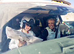 October 17, 2018 - Johnson Valley, California, U.S. - PENNY DALE, left, and THAYER COOK of Team Anam Cara take a lighthearted approach to being lost on Day 5 of the third annual Rebelle Rally, the first women's off-road navigation rally in the United States. The event features a unique scoring system in which precise navigation - not speed - is the ultimate goal.  With cell phones and GPS devices banned during the 10-day event, and armed with just maps, compasses and road books, 43 two-person teams are tasked with scoring points based on time, distance and hidden checkpoints as they make their way across 1,600 miles of scrub brush, sand dunes and boulders in the Nevada and California desert. (Credit Image: © Brian Cahn/ZUMA Wire)