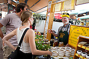 Dale Wolf of Wolf Honey Farms speaks to customers at the Lowertown Farmers Market,Saturday, May 31, 2014. [ BEN BREWER • Special to the Star Tribune _ Assignments #  20034753A  DATE: May 31, 2014 SLUG: greenline.vita EXTRA INFORMATION: