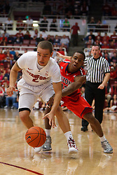 Feb 4, 2012; Stanford CA, USA;  Stanford Cardinal guard Aaron Bright (2) dribbles past Arizona Wildcats guard Josiah Turner (11) during the first half at Maples Pavilion.  Mandatory Credit: Jason O. Watson-US PRESSWIRE