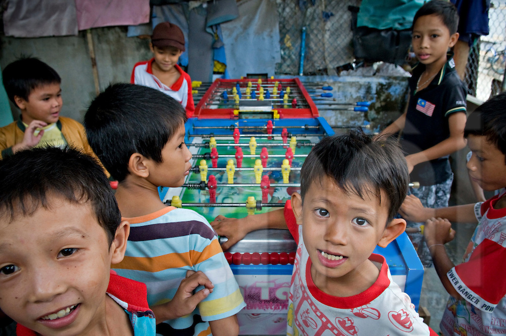 Young vietnamese boys play table football in the area of  Khanh Hoa province, Vietnam, Asia