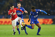 Leicester City midfielder Demarai Gray (22) controls the ball with the outside of his boot with Manchester United midfielder Henrikh Mkhitaryan (22) making a tackle during the Premier League match between Leicester City and Manchester United at the King Power Stadium, Leicester, England on 5 February 2017. Photo by Jon Hobley.