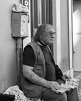 Egg Man. Morning Street Photography in Lisbon. Image taken with a Leica CL camera and 23 mm f/2 lens.