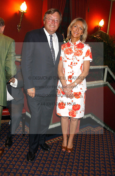 DAVID MELLOR and PENNY, VISCOUNTESS COBHAM at the presentation of a Chevalier dans l'ordre de la LŽgion d'Honneur to chef Albert Roux held at Le Gavroche, 43 Upper Brook Street, London on 9th September 2005.<br />