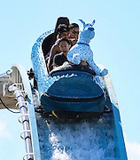 Stampede visitors try to keep cool on the Niagara Falls log ride as temperatures on the ground reached almost 30C in Calgary on Wednesday July 9, 2014. (Jenn Pierce/Calgary Herald)