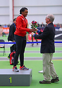 Keturah Orji receives her medal from Ed Burke (right) after winning the triple jump during the USA Indoor Track and Field Championships in Staten Island, NY, Sunday, Feb 24, 2019. (Rich Graessle/Image of Sport)