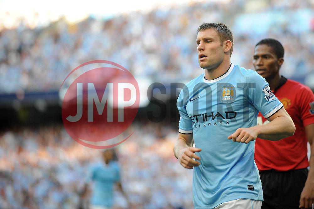 Manchester City's James Milner - Photo mandatory by-line: Dougie Allward/JMP - Tel: Mobile: 07966 386802 22/09/2013 - SPORT - FOOTBALL - City of Manchester Stadium - Manchester - Manchester City V Manchester United - Barclays Premier League