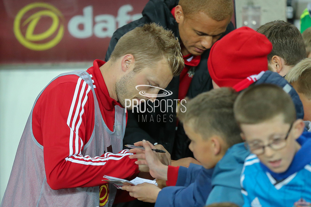 Sunderland midfielder Sebastian Larsson signing autographs  during the Capital One Cup match between Sunderland and Manchester City at the Stadium Of Light, Sunderland, England on 22 September 2015. Photo by Simon Davies.