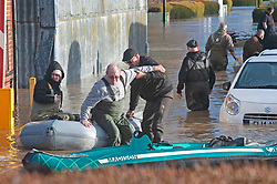 ©Licensed to London News Pictures 21/12/2019. <br /> Yalding ,UK. Resident getting off a boat. Little Venice Country Park and Marina in Yalding has been severely flooded, residents of the lodge and caravan community are having to use boats to get on and off the site. The River Medway in Yalding, Kent has bursts its banks causing severe flooding to the village.   Photo credit: Grant Falvey/LNP