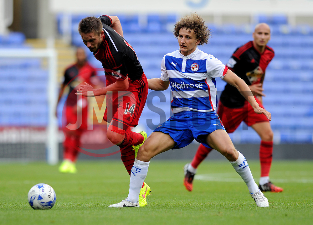 Reading's Aaron Kuhl tackles Swansea City's new signing, Gylfi Sigurdsson - Photo mandatory by-line: Dougie Allward/JMP - Mobile: 07966 386802 02/08/2014 - SPORT - FOOTBALL - Reading - Madejski Stadium - Reading v Swansea - Pre-Season Friendly