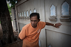 The father of Mr. Somchai, a taxidriver and Red-Shirt supporter, who was killed during the riots in Bangkok at Bon Kai intersection on May 16th. The father in front of their small house in Yasothoan province/ Ubon Ratchathani, the very North-East of Thai- land and the heartland of the Red-Shirt movement. For over two months, Thailand's capital was shaken by fierce and deadly clashes between protesters and security forces. The standoff has taken the lives of at least 89 people and left way more than 1,800 people injured so far.