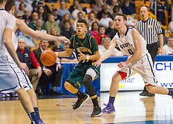 Huntington guard Tavian Dunn-Martin (11) looks to shoot against Parkersburg South during the Class AAA championship game at the Charleston Civic Center.