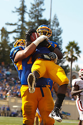 September 24, 2011; San Jose, CA, USA;  San Jose State Spartans running back Brandon Rutley (9) is congratulated by offensive tackle Andres Vargas (back) after scoring a touchdown against the New Mexico State Aggies during the fourth quarter at Spartan Stadium. San Jose State defeated New Mexico State 34-24.