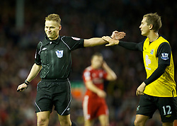LIVERPOOL, ENGLAND - Boxing Day Monday, December 26, 2011: Blackburn Rovers' Morten Gamst Pedersen and referee Mike Jones during the Premiership match against Liverpool at Anfield. (Pic by David Rawcliffe/Propaganda)