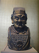 Gilt bronze head of a Buddhist guardian figure.  Yuan dynasty, 14th century AD.  Fierce armoured guardian figures were placed at the entrances to Buddhist temples in a protective capacity.