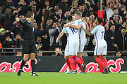 England attacker Adam Lallana (11) celebrates scoring penalty 1-0 during the Friendly match between England and Spain at Wembley Stadium, London, England on 15 November 2016. Photo by Matthew Redman.