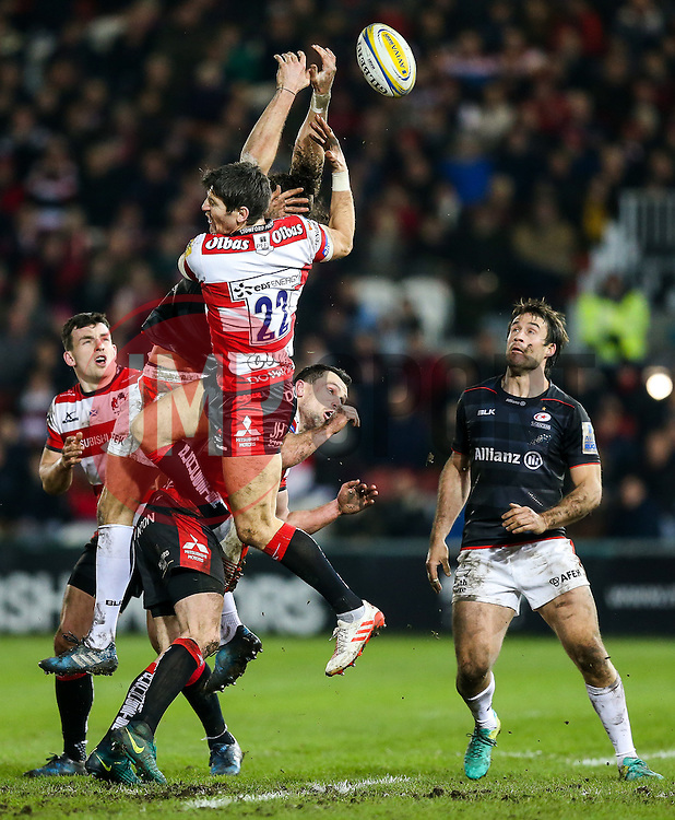 James Hook of Gloucester Rugby and Mike Ellery of Saracens challenge for a high ball - Rogan Thomson/JMP - 17/02/2017 - RUGBY UNION - Kingsholm Stadium - Gloucester, England - Gloucester Rugby v Saracens - Aviva Premiership.