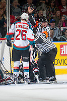 KELOWNA, CANADA - JANUARY 7: Chris Crich, referee makes a call between the Vancouver Giants and the Kelowna Rockets on January 7, 2015 at Prospera Place in Kelowna, British Columbia, Canada.  (Photo by Marissa Baecker/Shoot the Breeze)  *** Local Caption *** Chris Crich;