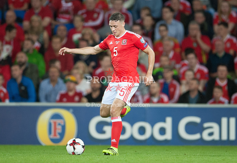 CARDIFF, WALES - Monday, September 5, 2016: Wales James Chester in action against Moldova during the 2018 FIFA World Cup Qualifying Group D match at the Cardiff City Stadium. (Pic by Ian Cook/Propaganda)
