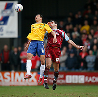Photo: Steve Bond.<br />Scunthorpe United v Nottingham Forest. Coca Cola League 1. 10/03/2007. Nathan Tyson (right) and Stephen Foster (left) contest