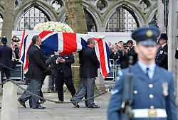 © Licensed to London News Pictures. 17/04/2013. London, United Kingdom. The funeral of Baroness Margaret Thatcher former British Prime Minister at St Paul Cathedral.   Baroness Margaret Thatchers body is taken into St Clement Danes in London on the 17th April 2013. Photo credit : Justin Setterfield/LNP