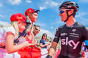 Two young fans try to get autographs from the cyclists and eventually succeed with Ben Swift of the Team Sky - The London-Surrey Classic professional race. Prudential RideLondon a festival of cycling, with more than 95,000 cyclists, including some of the world's top professionals, participating in five separate events over the weekend of 1-2 August.