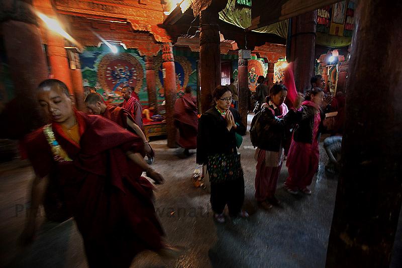 Monks practice inside the temple premises as devotees pray prior to performing sacred masked dances during the Hemis festival at the Hemis monastery in Leh, Kashmir, India, July 2, 2009. The Hemis Festival is held every year in the Hemis Monastery, the biggest Buddhist monastery of Ladakh. It is celebrated on the tenth day of lunar month in the Tibetan calendar. The festival is celebrated in the commemoration of the birth anniversary of Guru Padmasambhava. During the festival, the Lamas gather around the central flagpole in the courtyard of the monastery and perform mask dances and sacred plays..Photographer: Prashanth Vishwanathan.