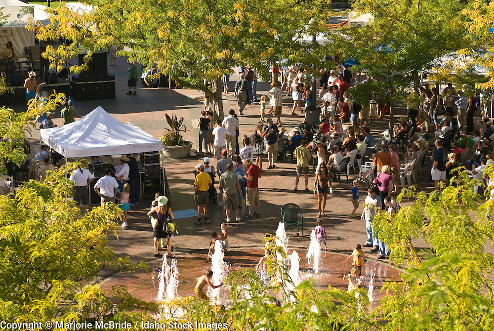 Crowd of people enjoying live music during summer at Alive After Five on the grove in downtown Boise, Idaho.