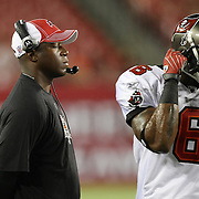 Tampa Bay head coach Raheem Morris breathes in deep and wide receiver Maurince Price (6) enter the game during an NFL football game between the New England Patriots and the Tampa Bay Buccaneers at Raymond James Stadium on Thursday, August 18, 2011 in Tampa, Florida.   (Photo/Alex Menendez)