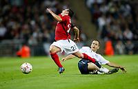 Photo: Richard Lane/Sportsbeat Images.<br />England v Germany. International Friendly. 22/08/2007. <br />England's Joe Cole fouls Germany's Piotr Trochowski.