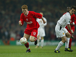 CARDIFF, WALES - Sunday, March 2, 2003: Liverpool's John Arne Riise take on Manchester United's Gary Neville during the Football League Cup Final at the Millennium Stadium. (Pic by David Rawcliffe/Propaganda)