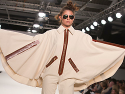 © Licensed to London News Pictures. 01/06/2014. London, England. Collection by Karina Jemmott from UCA Epsom Fashion - university for the creative arts. Graduate Fashion Week 2014, Runway Show at the Old Truman Brewery in London, United Kingdom. Photo credit: Bettina Strenske/LNP