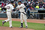Justin Morneau #33 of the Minnesota Twins is congratulated by Ryan Doumit #9 after hitting a home run against the New York Mets on April 13, 2013 at Target Field in Minneapolis, Minnesota.  The Mets defeated the Twins 4 to 2.  Photo: Ben Krause