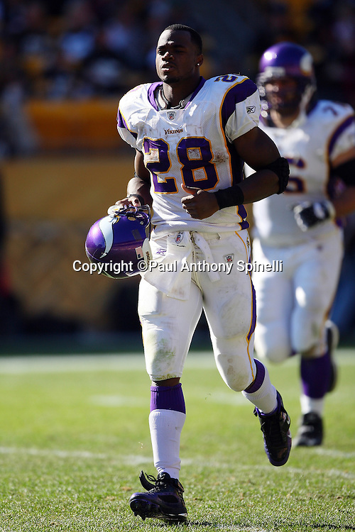 Minnesota Vikings running back Adrian Peterson (28) jogs onto the field during the NFL football game against the Pittsburgh Steelers, October 25, 2009 in Pittsburgh, Pennsylvania. The Steelers won the game 27-17. (©Paul Anthony Spinelli)